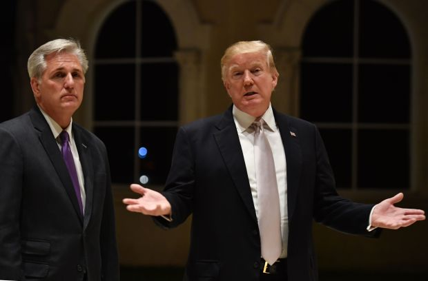 US President Donald Trump (R) speaks beside House Majority Leader Kevin McCarthy (L) at Trump International Golf Club in West Palm Beach on January 14, 2018. / AFP PHOTO / Nicholas KammNICHOLAS KAMM/AFP/Getty Images