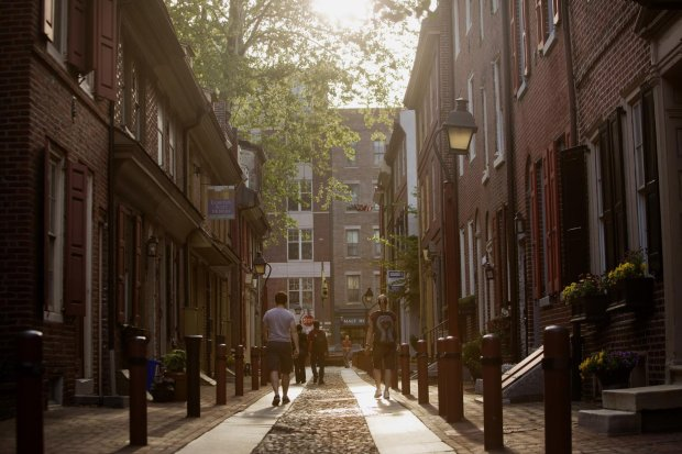 Pedestrians walk along Elferth's Alley, thought to be the nations oldestresidential street, in Philadelphia, May 9, 2015. MUST CREDIT: Bloomberg photo by Victor J. Blue.