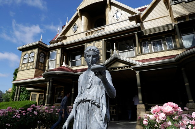 "This May 5, 2017, file photo, shows an exterior view of the Winchester Mystery House in San Jose, Calif. The site is featured in ""Ghostland: An American History in Haunted Places."" (AP Photo/Marcio Jose Sanchez, File)"