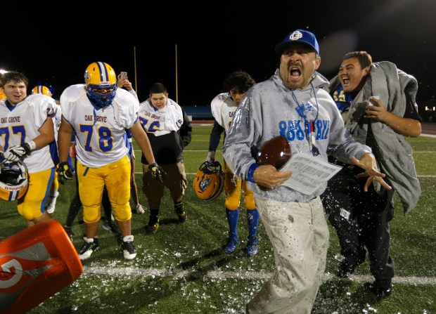 Oak Grove High School head coach Jay Braun reacts to being doused with liquid as they celebrate their 27-21 win against St. Francis High School for their CCS Open Division II championship football game at San Jose City College in San Jose, Calif., on Saturday, Dec. 5, 2015. (Nhat V. Meyer/Bay Area News Group)
