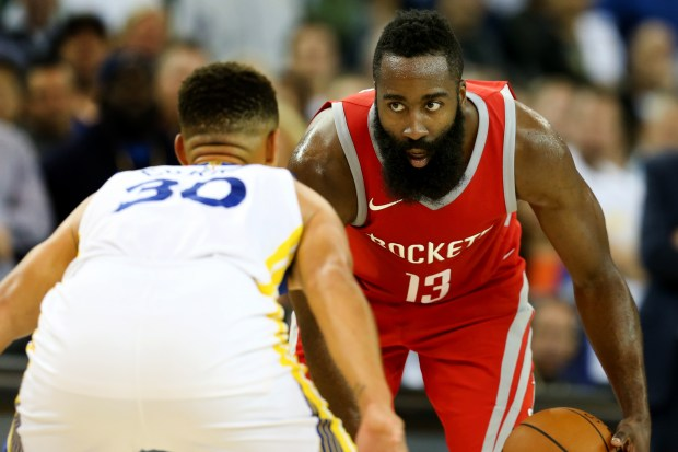 Houston Rockets' James Harden (13) dribbles against Golden State Warriors' Stephen Curry (30) in the second half of their season opener at Oracle Arena in Oakland, Calif., on Tuesday, Oct. 17, 2017. (Ray Chavez/Bay Area News Group)