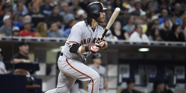 SAN DIEGO, CA - AUGUST 28: Brandon Crawford #35 of the San Francisco Giants hits a solo home run during the fourth inning of a baseball game against the San Diego Padres at PETCO Park on August 28, 2017 in San Diego, California. (Photo by Denis Poroy/Getty Images)