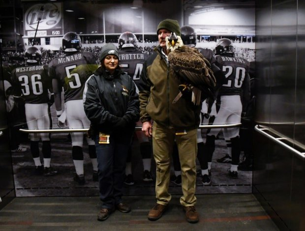 Michelle Bauer and Spencer Williams of the American Eagle Foundation ridean elevator with Challenger to an upper deck at Lincoln Financial Field before a game between the Philadelphia Eagles and the Dallas Cowboys. MUST CREDIT: Photo by Eileen Blass for The Washington Post.