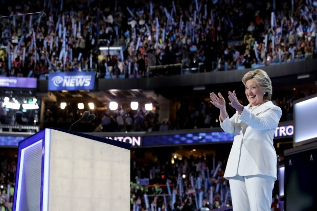 PHILADELPHIA, PA - JULY 28: Democratic presidential candidate Hillary Clinton acknowledges the crowd after delivering a speech at the end of the fourth day of the Democratic National Convention at the Wells Fargo Center, July 28, 2016 in Philadelphia, Pennsylvania. Democratic presidential candidate Hillary Clinton received the number of votes needed to secure the party's nomination. An estimated 50,000 people are expected in Philadelphia, including hundreds of protesters and members of the media. The four-day Democratic National Convention kicked off July 25. (Photo by Chip Somodevilla/Getty Images)