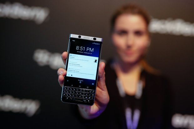 An attendee holds the Blackberry KeyOne smartphone during its launch eventahead of the Mobile World Congress in Barcelona, Spain, on Feb. 25, 2017. (MUST CREDIT: Pau Barrena/Bloomberg)