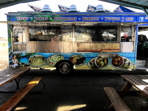 Covered picnic tables offer plenty of seating at Tita's Pupuseria foodtruck in Buttonwillow. (Courtesy of Mary Orlin)