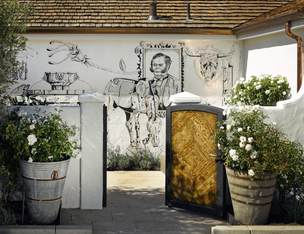 Don't miss a stroll through the garden where historic murals adorn thewalls at Sonoma's Three Sticks Wines tasting room. (Courtesy Ken Fulk)