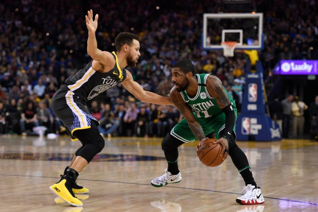 Golden State Warriors' Stephen Curry (30) guards Boston Celtics' Kyrie Irving (11) during the first quarter of their NBA game at the Oracle Arena in Oakland, Calif. on Saturday, Jan. 27, 2018. (Jose Carlos Fajardo/Bay Area News Group)