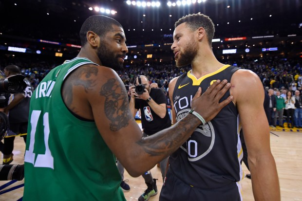 Boston Celtics' Kyrie Irving (11) shares words with Golden State Warriors' Stephen Curry (30) after their NBA game at the Oracle Arena in Oakland, Calif. on Saturday, Jan. 27, 2018. The Golden State Warriors defeated the Boston Celtics 109-105. (Jose Carlos Fajardo/Bay Area News Group)