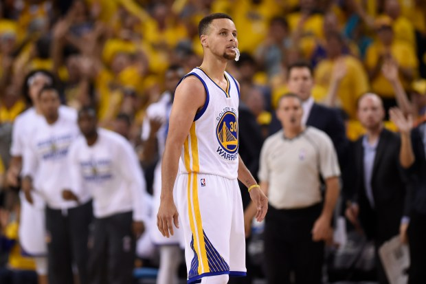 Golden State Warriors' Stephen Curry (30) walks on the floor during a timeout against the Cleveland Cavaliers in the fourth quarter of Game 7 of the NBA Finals at Oracle Arena in Oakland, Calif., on Sunday, June 19, 2016. The Cleveland Cavaliers defeated the Golden State Warriors 93-89 to win the NBA championship. (Jose Carlos Fajardo/Bay Area News Group)