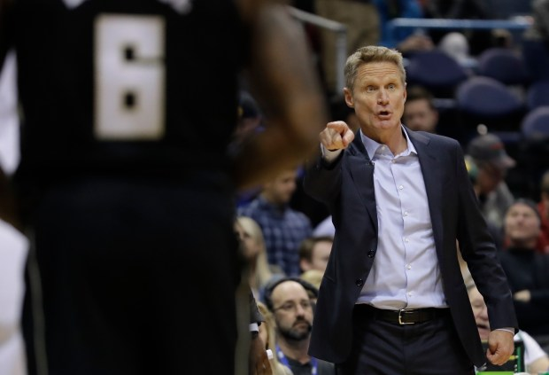 Golden State Warriors head coach Steve Kerr yells during the first half of an NBA basketball game against the Milwaukee Bucks Friday, Jan. 12, 2018, in Milwaukee. (AP Photo/Morry Gash)