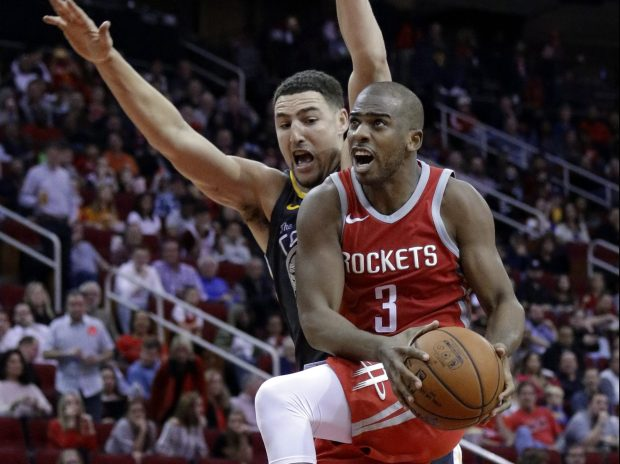 Houston Rockets guard Chris Paul (3) shoots in front of Golden State Warriors guard Klay Thompson (11) during the second half of an NBA basketball game Saturday, Jan. 20, 2018, in Houston. (AP Photo/Michael Wyke)