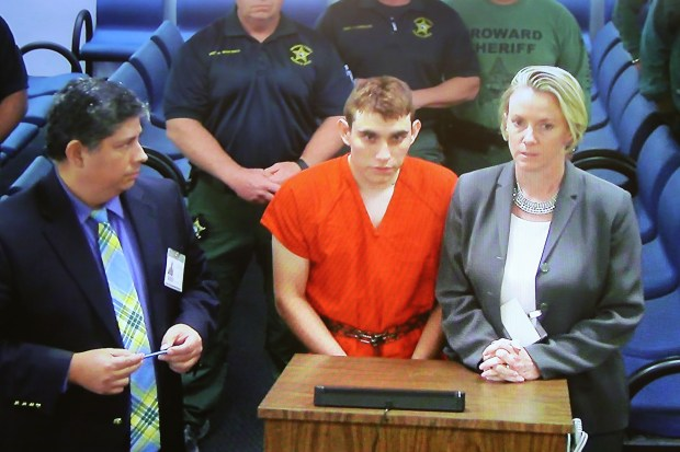 Nikolas Cruz, 19, a former student at Marjory Stoneman Douglas High School in Parkland, Florida, where he allegedly killed 17 people, is seen on a closed circuit television screen during a bond hearing in front of Broward Judge Kim Mollica at the Broward County Courthouse on February 15, 2018 in Fort Lauderdale, Florida. Mr. Cruz is possibly facing 17 counts of premeditated murder in the school shooting. (Photo by Susan Stocker - Pool/Getty Images)