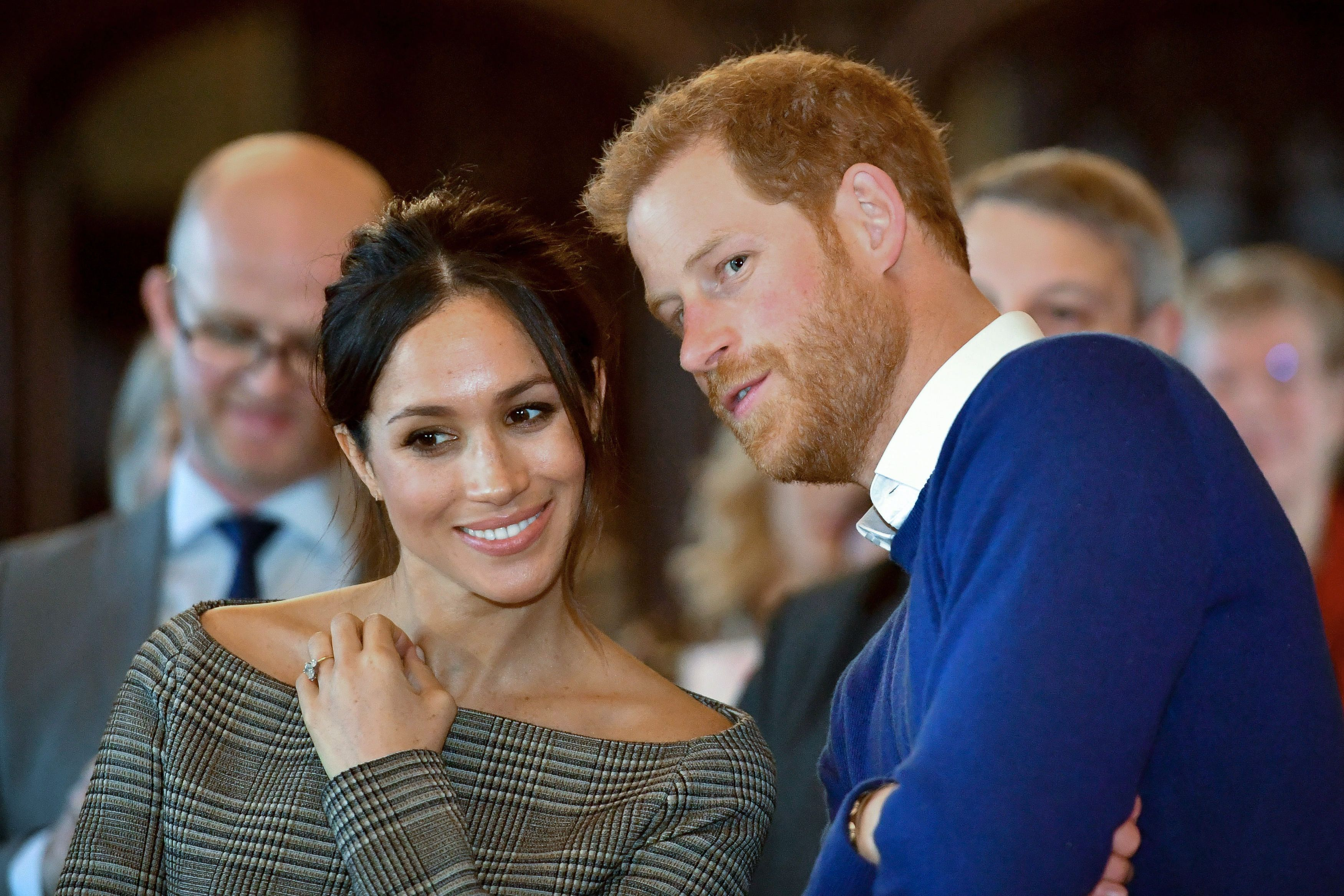TOPSHOT- Britain's Prince Harry and his fiancée US actress Meghan Markle watch a dance performance by Jukebox Collective during a visit at Cardiff Castle in Cardiff south Wales