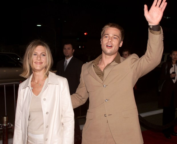 Brad Pitt and Jennifer Aniston at the premiere of 'The Mexican' at the National Theater in Los Angeles, Ca. 2/23/01. (Photo by Kevin Winter/Getty Images).