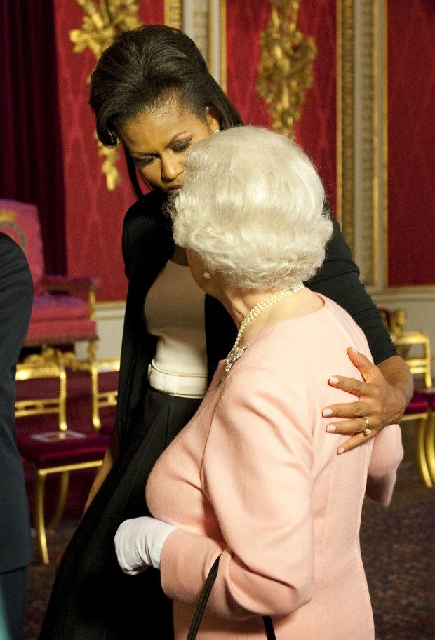 Michelle Obama, wife of U.S. President Barack Obama, left, walks with Britain's Queen Elizabeth II at the reception at Buckingham Palace in London Wednesday, April 1, 2009. (AP Photo/Daniel Hambury, pool)