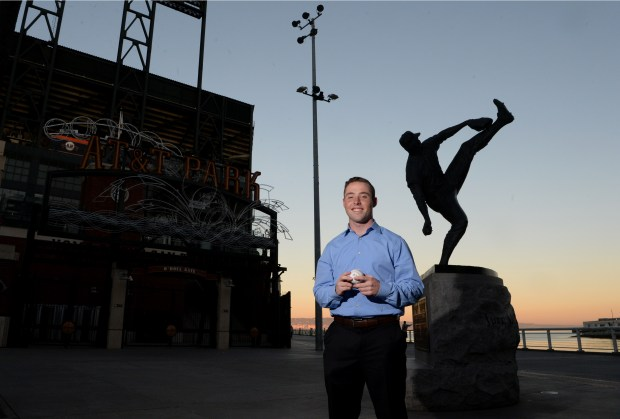 Kerry Crowley, Bay Area News Group's San Francisco Giants beat writer, is photographed at AT&T Park next the statue of Juan Marichal in San Francisco, Calif., on Thursday, Feb. 8, 2018. (Doug Duran/Bay Area News Group)