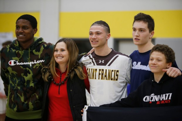 Saint Francis' Logan Johnson (2), center, takes a picture with friend Bellarmine's Jake Wojcik (4) and others during a pre-game ceremony before his teams' game at St. Francis High gym on Tuesday, Feb. 13, 2018. (RandyVazquez/ Bay Area News Group)