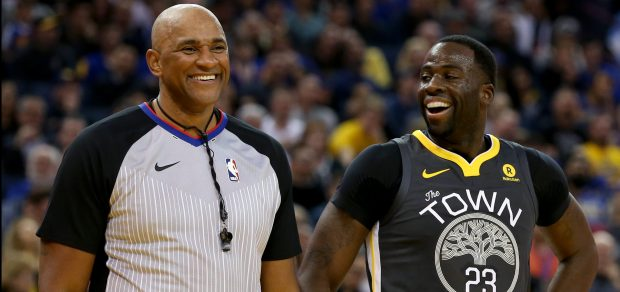 Golden State Warriors' Draymond Green (23) smiles while talking with official Kevin Cutler in the second period of a NBA game against the San Antonio Spurs at Oracle Arena in Oakland, Calif., on Saturday, Feb. 10, 2018. (Anda Chu/Bay Area News Group)