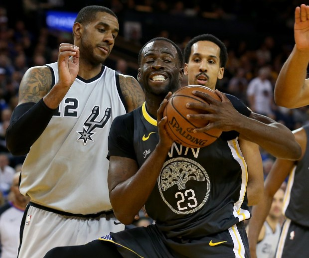 Golden State Warriors' Draymond Green (23) grabs the rebound against San Antonio Spurs' LaMarcus Aldridge (12) in the second period of a NBA game at Oracle Arena in Oakland, Calif., on Saturday, Feb. 10, 2018. (Anda Chu/Bay Area News Group)