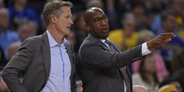 Golden State Warriors head coach Steve Kerr chats with assistant coach Mike Brown during a timeout in the second quarter of their NBA game against the Phoenix Suns at the Oracle Arena in Oakland, Calif., on Monday, Feb. 12, 2018. (Jose Carlos Fajardo/Bay Area News Group)