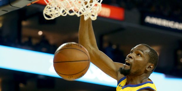 Golden State Warriors' Kevin Durant (35) dunks in the first quarter of their NBA game against the Oklahoma City Thunder at the Oracle Arena in Oakland, Calif., on Saturday, Feb. 24, 2018. (Jane Tyska/Bay Area News Group)