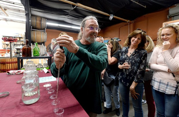 Mike Eckert, owner of Eckert Estate Winery, talks about his distilling of brandy from wine as he prepares a tasting in Livermore, Calif., on Saturday, March 25, 2017. Many wine enthusiasts flocked to Livermore wineries over the barrel tasting weekend. (Dan Honda/Bay Area News Group)