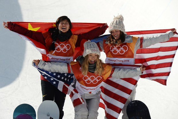 Silver medalist Jiayu Liu of China, gold medalist Chloe Kim of the United States and bronze medalist Arielle Gold of the United States pose during the victory ceremony for the Snowboard Ladies' Halfpipe Final on day four of the PyeongChang 2018 Winter Olympic Games at Phoenix Snow Park. February 12, 2018. (Photo by Hyoung Chang/The Denver Post)