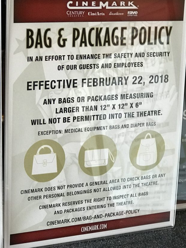A sign posted inside the Century Theatres 16 Downtown Pleasant Hill in Pleasant Hill, Calif., alerts moviegoers Wednesday, Feb. 21, 2018 about a new bag and package policy beginning Thursday.