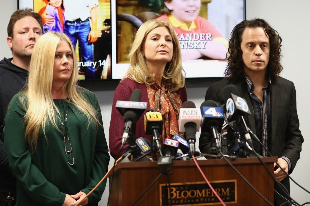 WOODLAND HILLS, CA - FEBRUARY 14: Attorney Lisa Bloom (C) speaks during a press conference with Nicole Eggert (L) and Alexander Polinsky regarding sexual harassment allegations against Scott Baio at The Bloom Firm on February 14, 2018 in Woodland Hills, California. Polinsky is the second person, along with Nicole Eggert, to costarred with Baio in the 1980?s sitcom ?Charles in Charge? who have accused him of sexual harassment. Both Polinsky and Eggert were minors at the time. (Photo by Frederick M. Brown/Getty Images)