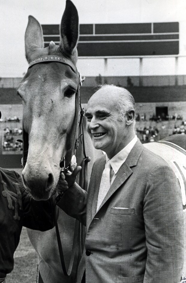"Oakland Athletics owner Charles Finley with his mascot Charlie ""O"" the mule. (1972 photo by Ron Riesterer)"