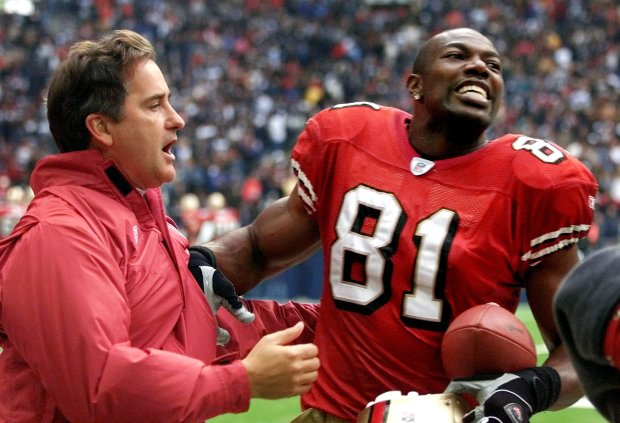 San Francisco 49ers head coach Steve Mariucci, left, and wide reciever Terrell Owens (81) celebrate following Owens' second touchdown of the game against the Dallas Cowboys in the 31-27 49ers win, Sunday Dec. 8, 2002, at Texas Stadium in Irving, Texas. (AP Photo/Donna McWilliam)