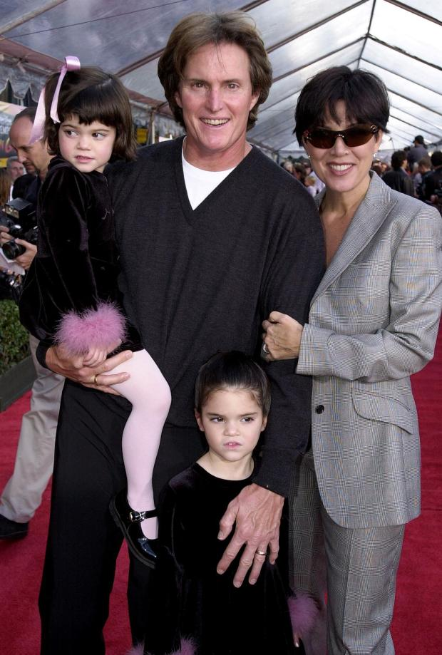 "HOLLYWOOD, : Former US gold medal decathlete Bruce Jenner (C), his wife Kris (R) and children Kylie (L) and Kendall (BELOW) appear at the, 10 December 2000, premiere of Walt Disney's ""The Emperor's New Groove"" at the El Capitan Theater in Hollywood, CA. The film opens in the US on 15 December 2000 AFP Photo/Scott NELSON (Photo credit should read Scott Nelson/AFP/Getty Images)"