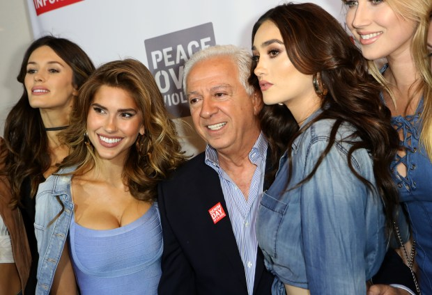 LOS ANGELES, CALIFORNIA - MARCH 22: Models Natalie Pack, Kara Del Toro, GUESS Foundation president Paul Marciano, models Olga Caro and Kristina Schlesinger attend the GUESS Foundation and Peace Over Violence Denim Day Cocktail Event at at MOCA Grand Avenue on March 22, 2016 in Los Angeles, California. (Photo by Ari Perilstein/Getty Images for GUESS)