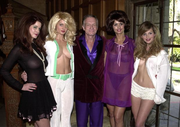 382949 04: Playboy founder Hugh Hefner, center, poses with playmates, left to right, Carrie Stevens, Kalin Olson, Karen McDougal and Deanna Brooks dressed as pinup girls December 7, 2000 at the Playboy Mansion in Los Angeles, CA. Hefner announced the sale of four rare Alberto Vargas watercolors to be sold on the new Playboy Auctions web site. Vargas'' classic watercolors of pinup girls appeared in Playboy magazine in the 1960''s. (Photo by Vince Bucci/Newsmakers)
