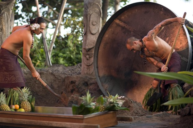 Roasted pig is unearthed for a feast of kalua pork with all the trimmings at theDrums of the Pacific Luau on Maui. (Hyatt Regency Maui)