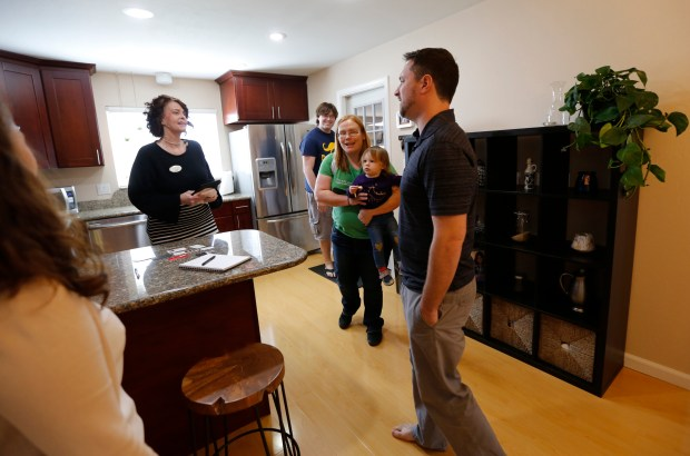 Real estate agent Brandy Reading talks with Matt Furman, right, home owner, as her clients Trevor, Eliza and 2-year-old Gwendolyn Masters tours the 3 bedroom, 2 bath home in San Jose, Calif., owned by Matt and Brooke Furman on Saturday, Feb. 10, 2018 during an open house. The Furmans are selling their home in hopes of moving closer to the Santa Cruz mountains. (Laura A. Oda/Bay Area News Group)