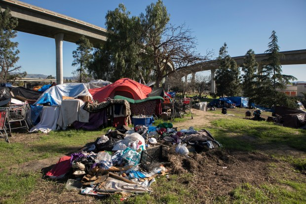 "Many homeless live in the encampment off Felipe Avenue next to the 101 and 280 freeways in San Jose, California, on Saturday, February 3, 2018. CalTrans recently notified residents of San Jose's largest homeless encampment since the ""Jungle"" that it will evict them with a massive sweep on Monday morning, February 5. (LiPo Ching/Bay Area News Group)"