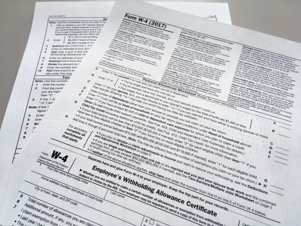 For most filers, TurboTax.com, TaxAct.com and HRBlock.com provide the easiest and most economical ways to do taxes. (AP Photo/Barbara Woike)