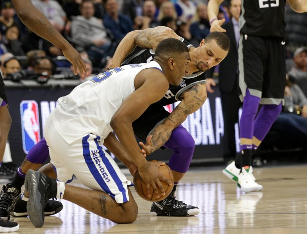 Golden State Warriors forward Kevon Looney, left, comes up with the ball next to Sacramento Kings guard George Hill during the second half of an NBA basketball game Friday, Feb. 2, 2018, in Sacramento, Calif. The Warriors won 119-104. (AP Photo/Rich Pedroncelli)