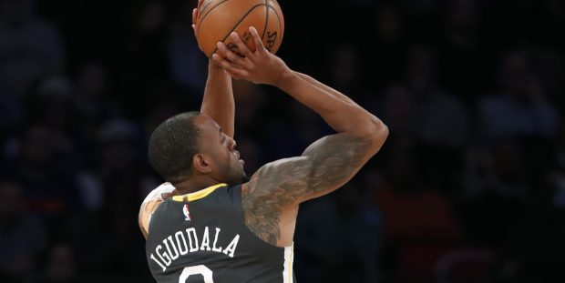 Golden State Warriors forward Andre Iguodala (9) shoots a three-point basket during the second half of an NBA basketball game against the New York Knicks, Monday, Feb. 26, 2018, in New York. (AP Photo/Kathy Willens)