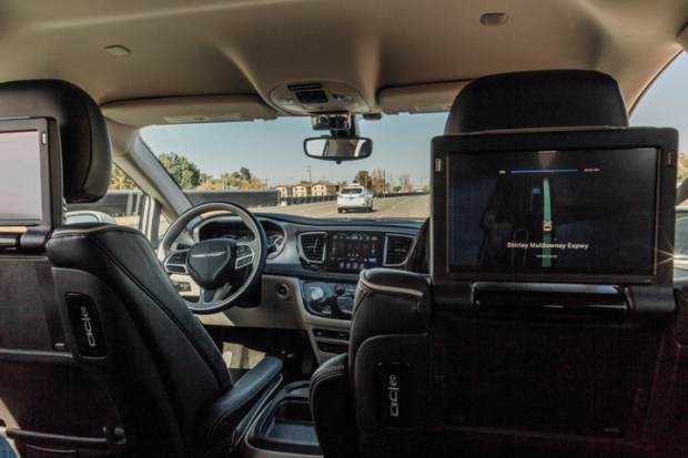 This Sunday, Oct. 29, 2017, photo provided by Waymo shows a Chrysler Pacifica minivan that are equipped with Waymo's self-driving car technology, being tested at Waymo's facility in Atwater, Calif. (Julia Wang/Waymo via AP)