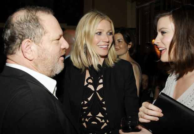 "NEW YORK - APRIL 28: Head of The Weinstein Company Harvey Weinstein, actress Gwyneth Paltrow, and actress Liv Tyler attend the after-party for ""Iron Man"" hosted by The Cinema Society and Michael Kors at The Odeon on April 28, 2008 in New York City. (Photo by Stephen Lovekin/Getty Images)"