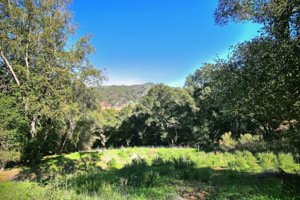 This almost 10-acre property at 17440 Chesbro Lake Drive fronts Chesbro Lake.