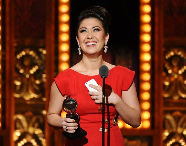 """2015: Ruthie Ann Miles accepts the Tony award for best performance by an actress in a featured role in a musical for """"The King & I"""" (Photo by Charles Sykes/Invision/AP, File)"""