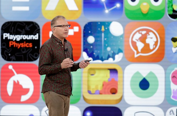 Greg Joswiak, vice president of iOS, iPad and iPhone product marketing, speaks during an Apple event at Lane Technical College Prep High School, Tuesday, March 27, 2018, in Chicago. (AP Photo/Charles Rex Arbogast)
