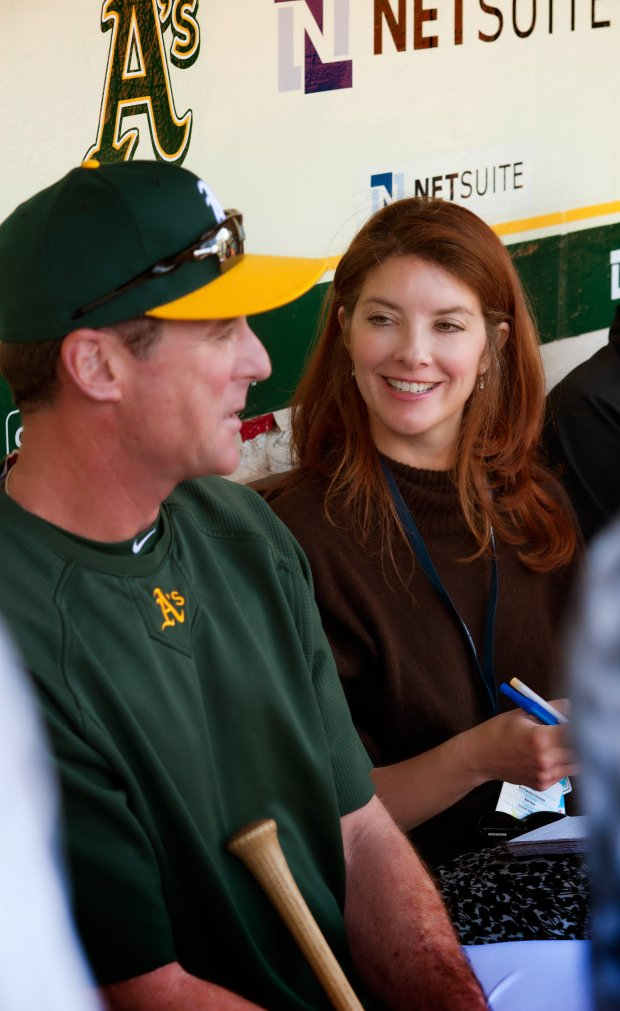 Susan Slusser, in her 20th season of covering the A's, interviews managerBob Melvin. (Photo: Paul Schraub)