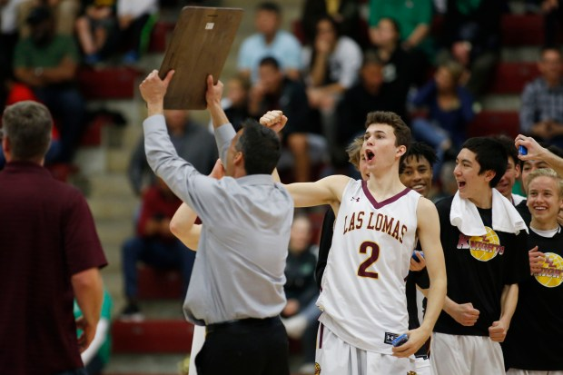 Las Lomas players celebrate after winning the CIF NorCal Division I boys championship game at Leavey Center in Santa Clara, Calif. on Saturday, March 17, 2018. Las Lomas would go on to win 44-41 over Palo Alto. (Randy Vazquez/ Bay Area News Group)