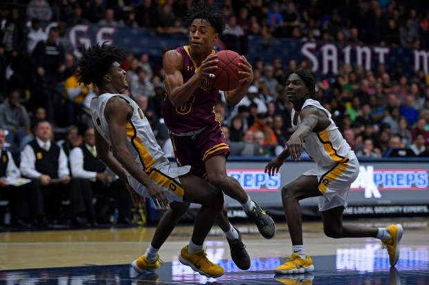 Las Lomas' Robert Prince (3) drives past Bishop O'Dowd's Brenden Patrick (3) in the first half of their North Coast Section Division II championship game at McKeon Pavilion at Saint Mary's College in Moraga, Calif. on Saturday, March 3, 2018. (Jose Carlos Fajardo/Bay Area News Group)