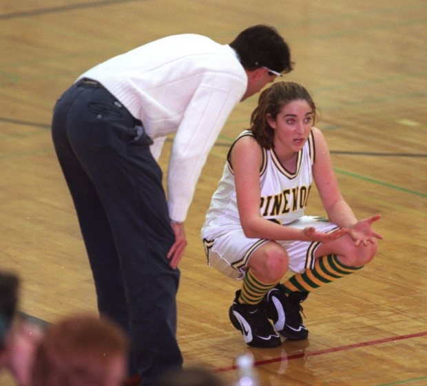 "PHOTO: Kacey Scheppler, 15, has a tough coach in her dad, Ernest ""Doc"" Scheppler, at left, [960308 LO 6B PE 3] B,6,P 3/08 DAD 13p4 x 2.75i ZOG PHOTO BY TOM VAN DYKE--KACEY DAD--Kacey Scheppler has a tough coach in her dad, Doc Scheppler. 2/29/96"